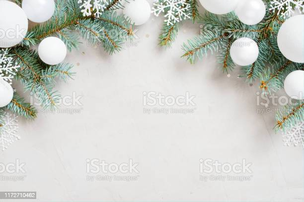 White christmas background with christmas tree branches snowflakes picture id1172710462?b=1&k=6&m=1172710462&s=612x612&h=ynbwgefcteuyovx3boqczurz 3l5zvgb4ueznazvn0y=