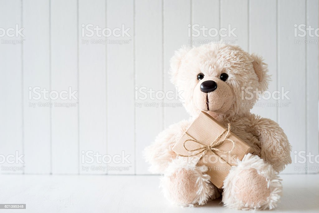 White Christmas background with teddy bear - copy space stock photo