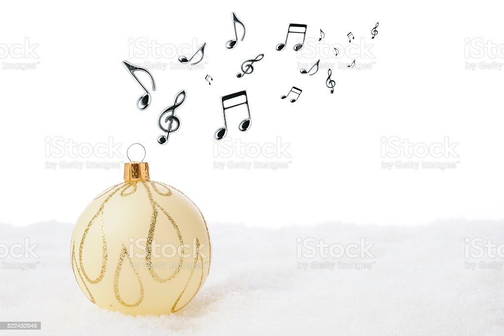 White Christmas ball on the snow with musical note stock photo