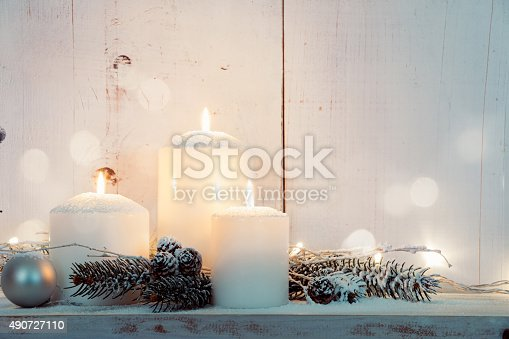 istock White Christmas candles 490727110