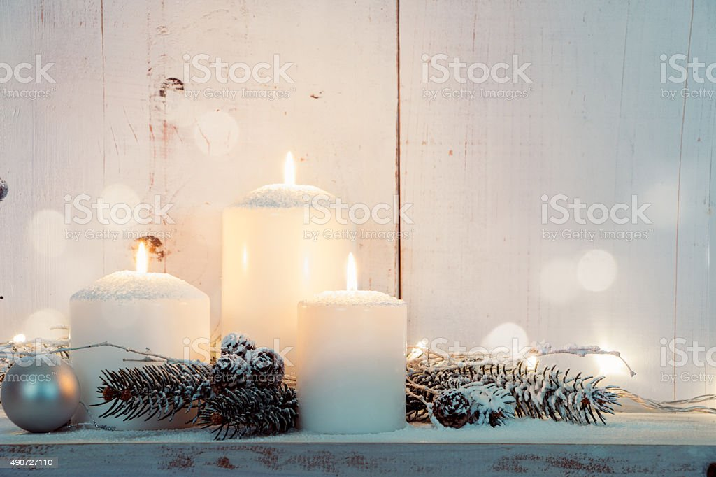 White Christmas candles stock photo
