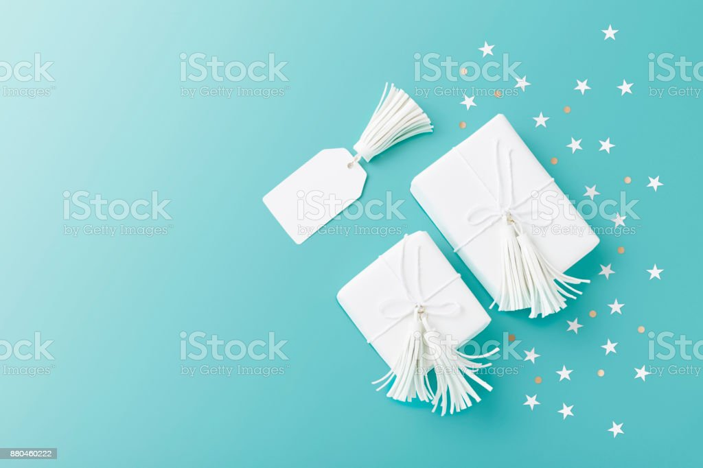 White Christmas Gifts on blue background stock photo