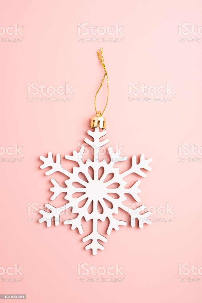 white christmas snowflakes decoration on pink background christmas picture id1081090454