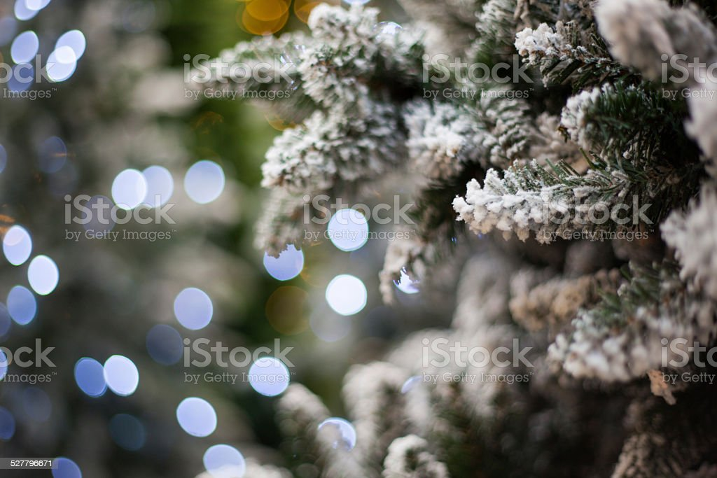 white christmas tree with bokeh lights stock photo