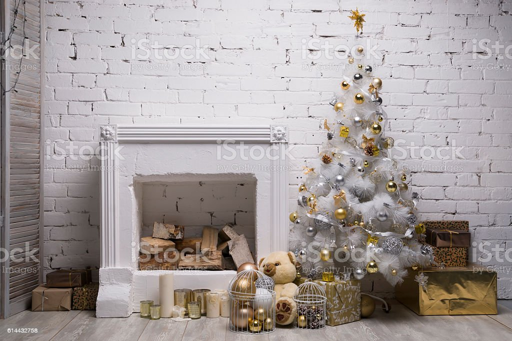 White Christmas tree with golden and silver balls, gift boxes stock photo