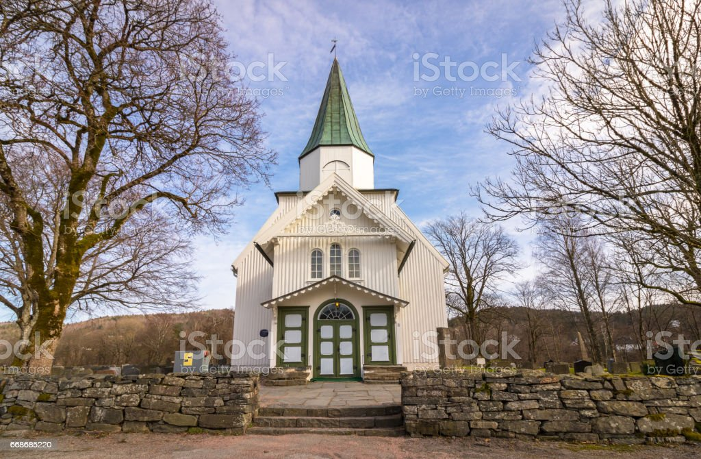 White church and blue sky with small clouds in Norway stock photo