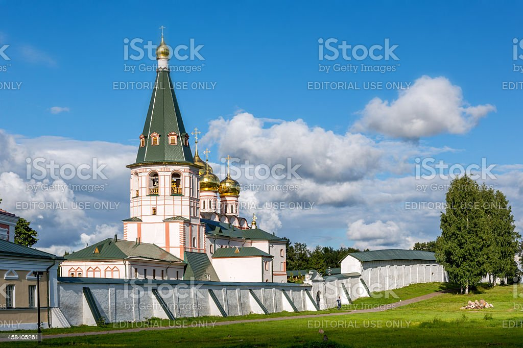 White church behind stone wall royalty-free stock photo