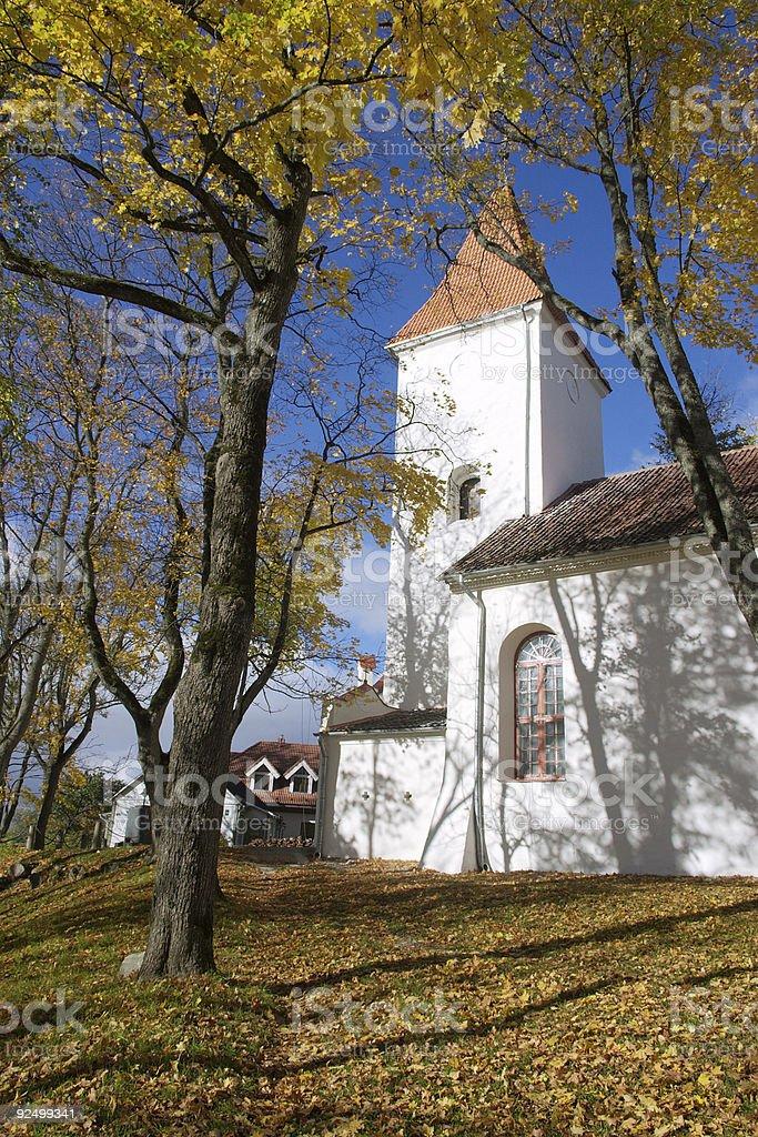 White church in autumn royalty-free stock photo