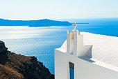 White church on Santorini island, Greece. Beautiful sea view. Famous travel destination