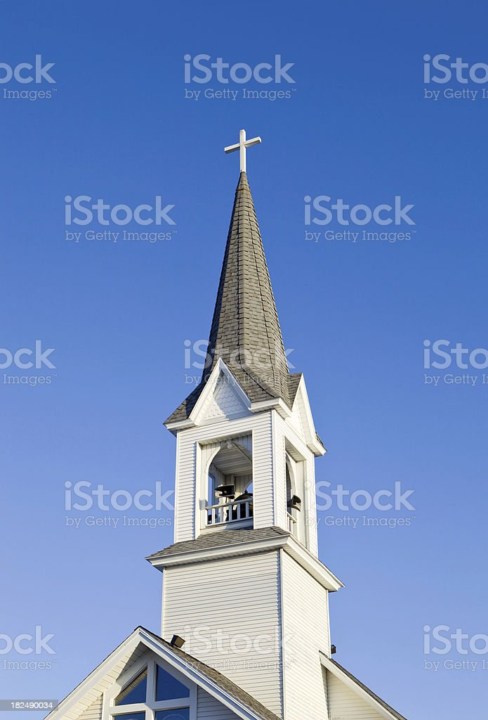 White Church Steeple against a Clear Blue Sky stock photo