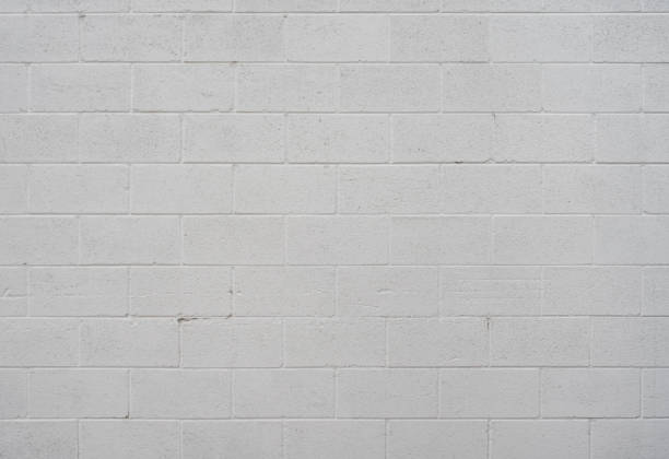 weiße schlackenbetonblock wand - betonblock wände stock-fotos und bilder