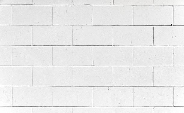 weiße cinderblock wand. - betonblock wände stock-fotos und bilder