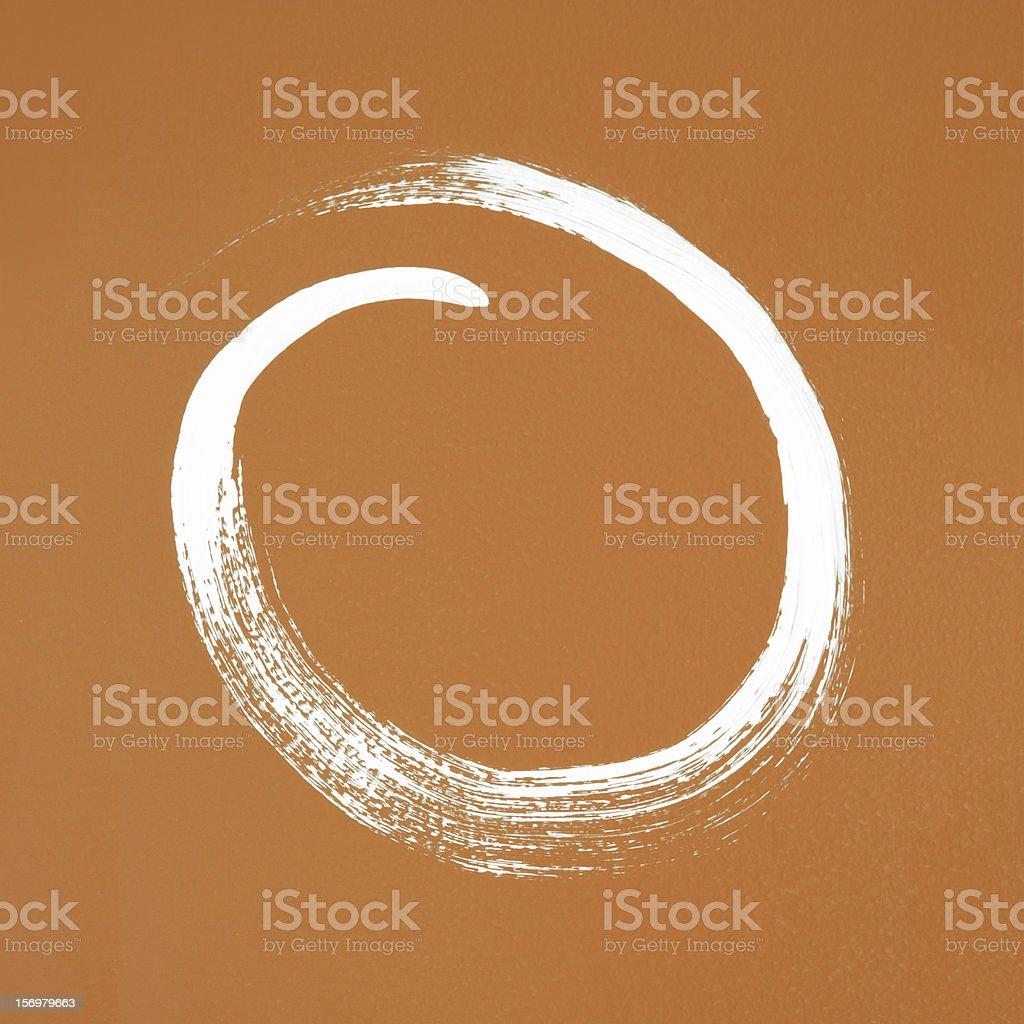 White circle painted on orange background stock photo