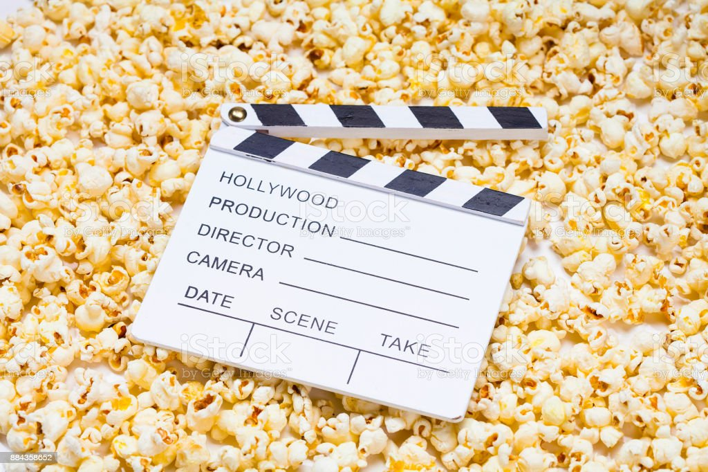 White Clapperboard on popcorns stock photo