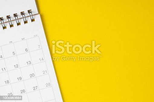 istock White clean calendar on solid yellow background with copy space, business, travel or project planning concept 1005983884