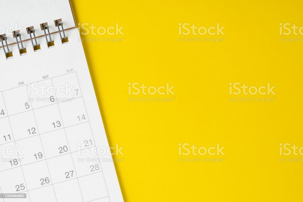 White clean calendar on solid yellow background with copy space, business, travel or project planning concept stock photo