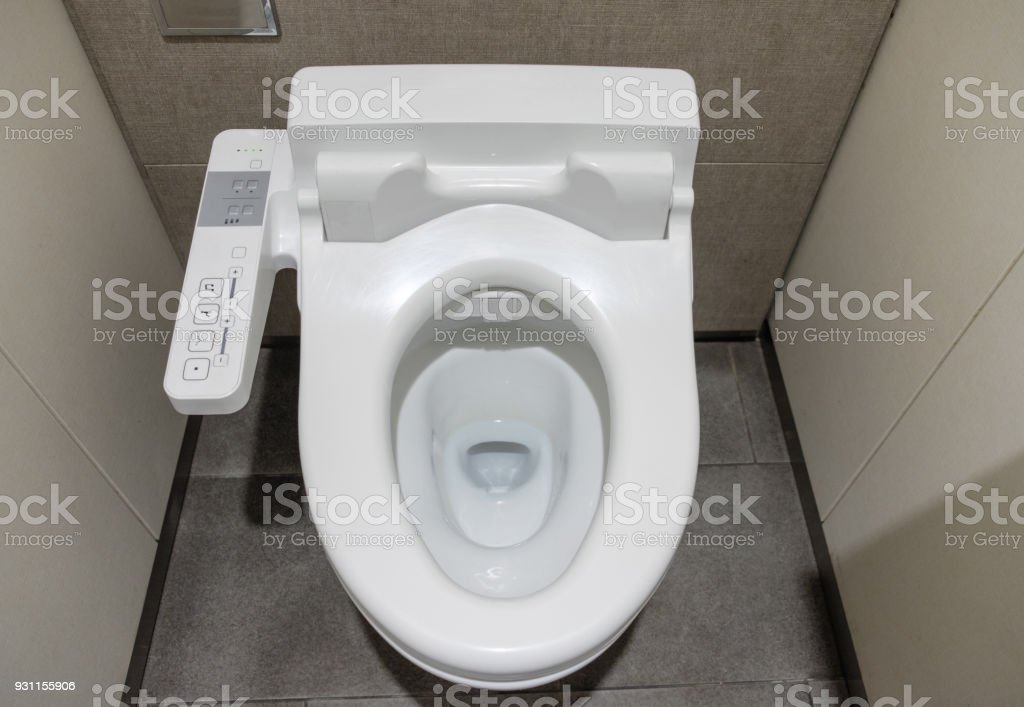 White clean innovation comfortable flush toilet stock photo