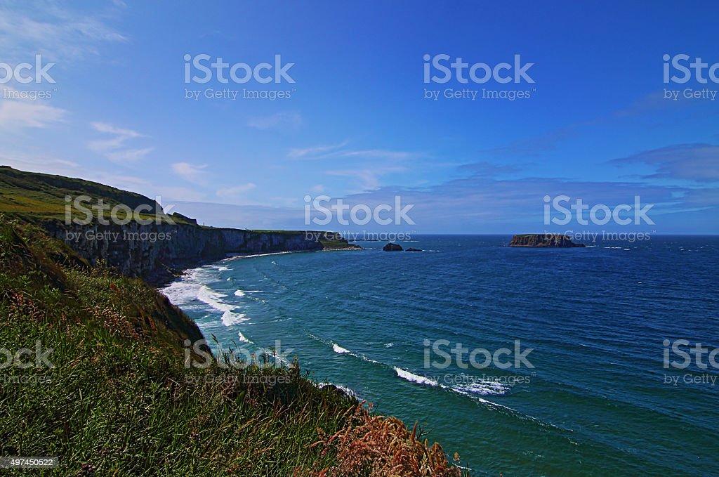White Cliffs along Irish Coast next to Carrick-a-rede island stock photo