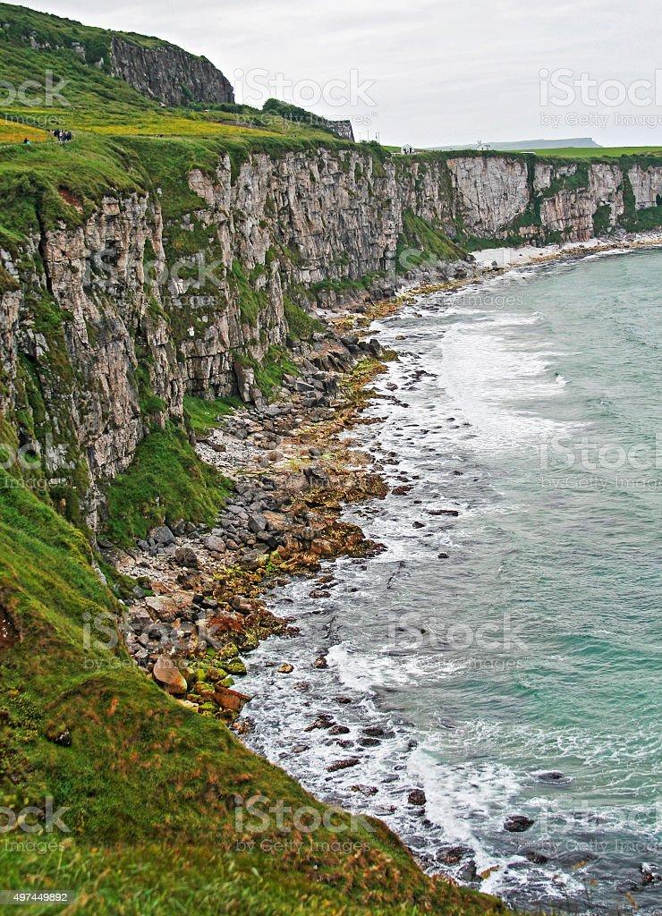 White Cliffs along Irish Coast next to tiny Carrick-a-rede island stock photo