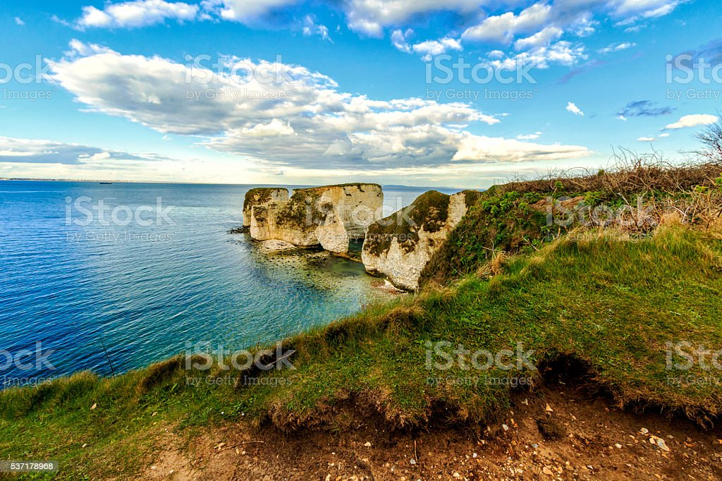 White cliffs in emerald sea stock photo