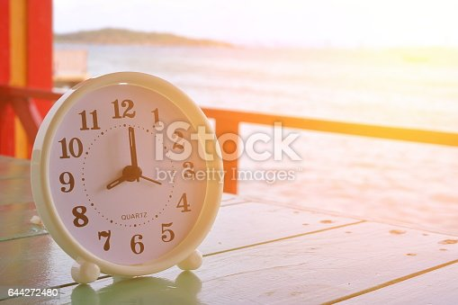 1128982514 istock photo White clock at 8am on the sea background 644272480