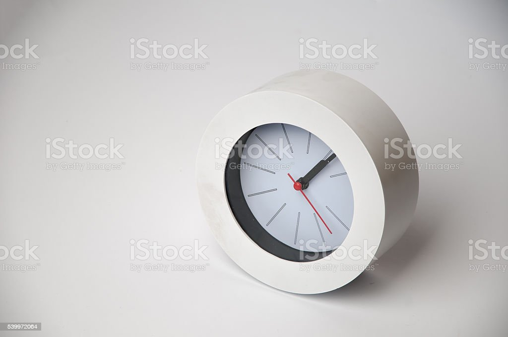White clock isolated on a white background stock photo