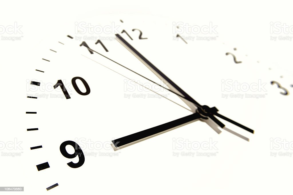 White clock with black numbers and hands stock photo