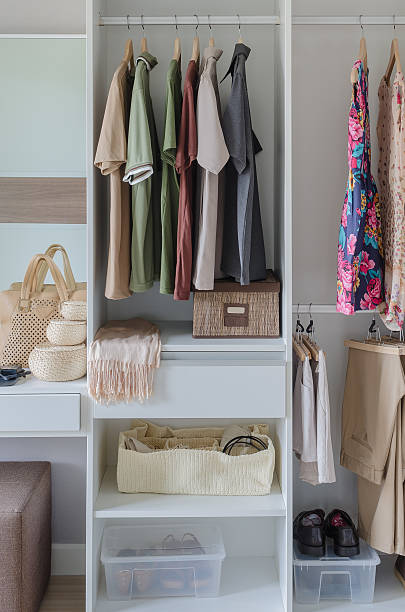 white closet with clothes, shirts, and accesories stock photo