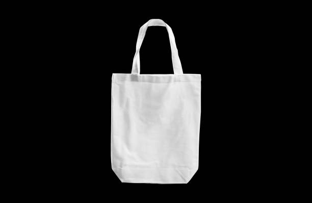 white cloth bag isolated on black background with clipping path - tote bag imagens e fotografias de stock