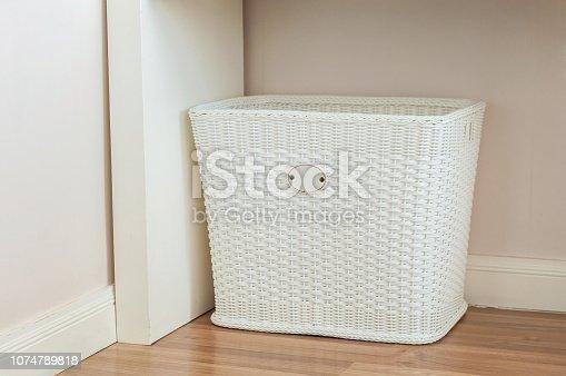 istock White Cloth basket on floor in room interior 1074789818