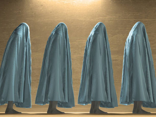 White clothed figures stock photo