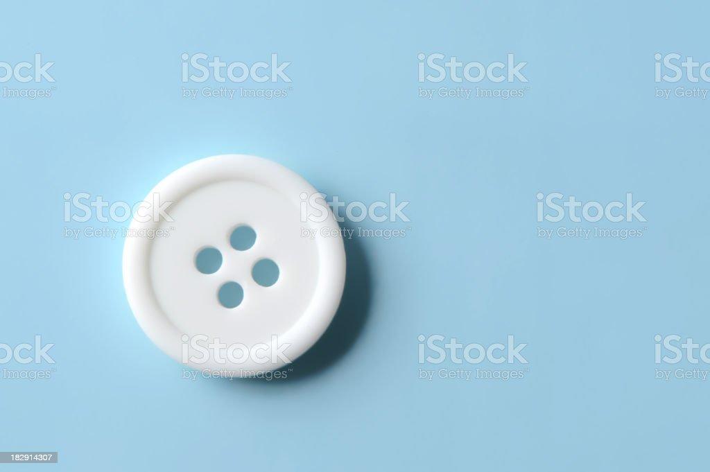 White Clothing Button on Blue royalty-free stock photo