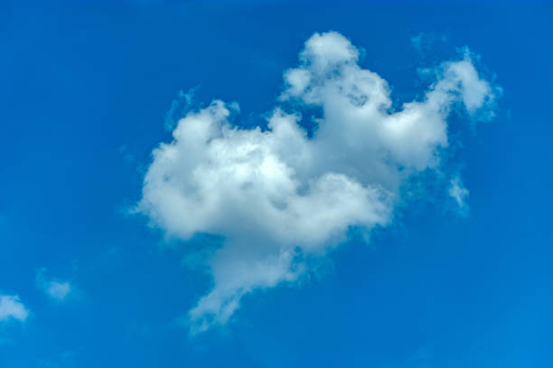 white cloud in deep blue sky stock photo