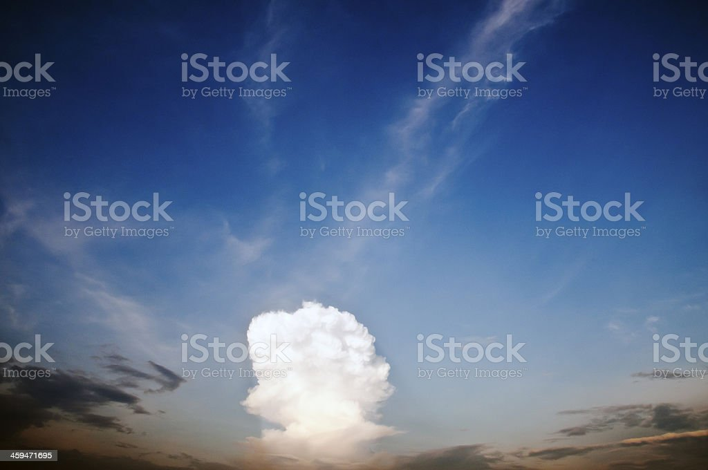 white cloud rising in a dark sky royalty-free stock photo