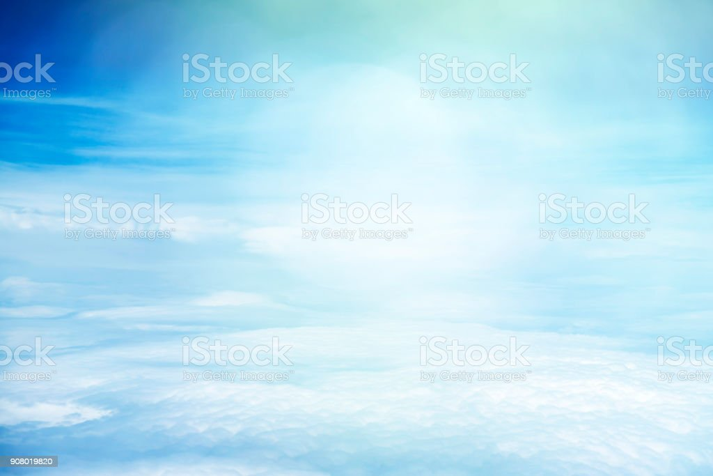 White clouds and blue sky view from airplane window. stock photo