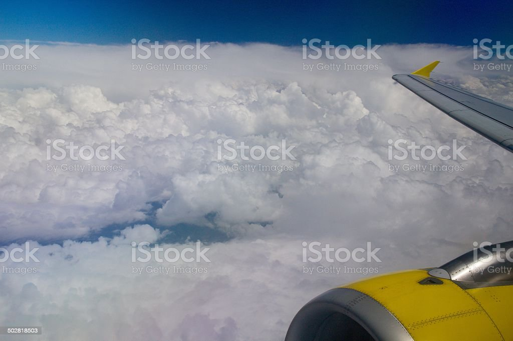 White clouds and plane royalty-free stock photo