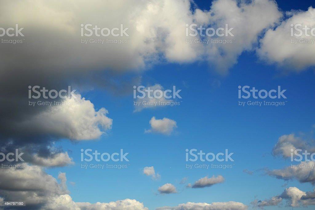 White Clouds Around Blue Sky With Sunlight stock photo