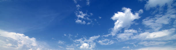 White clouds drifting in the blue sky Cumulus, altocumulus and cirrus clouds drifting in the blue sky on a sunny summer day. altocumulus stock pictures, royalty-free photos & images