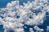 fluffy cummulo clouds taken from above