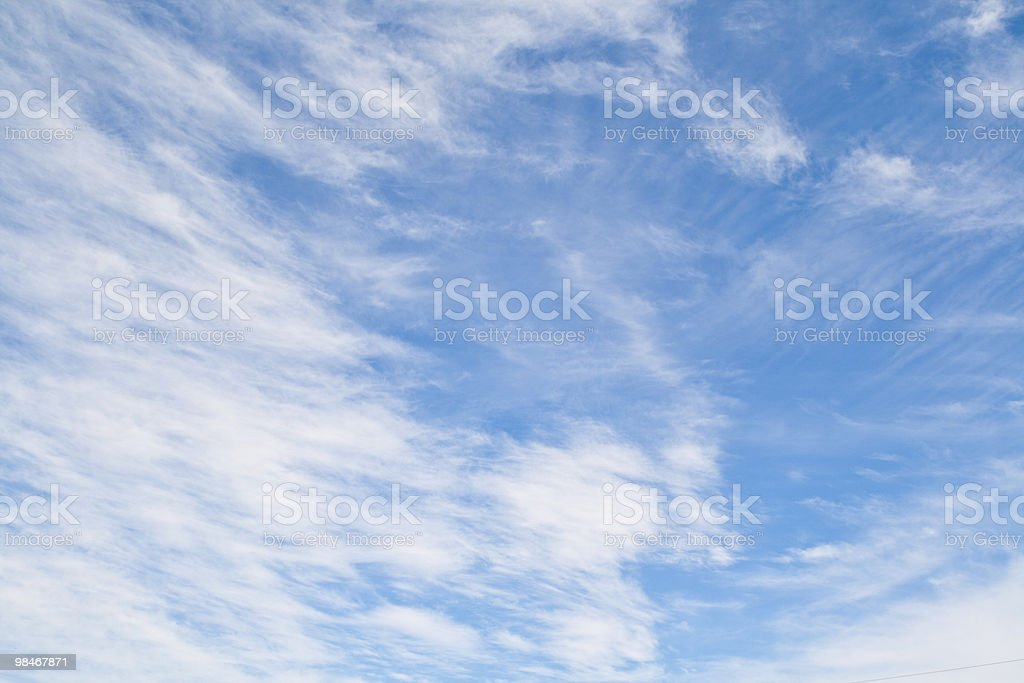 White clouds in a blue sky royalty-free stock photo