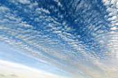 Blue evening sky with fleece and spindrift clouds background.