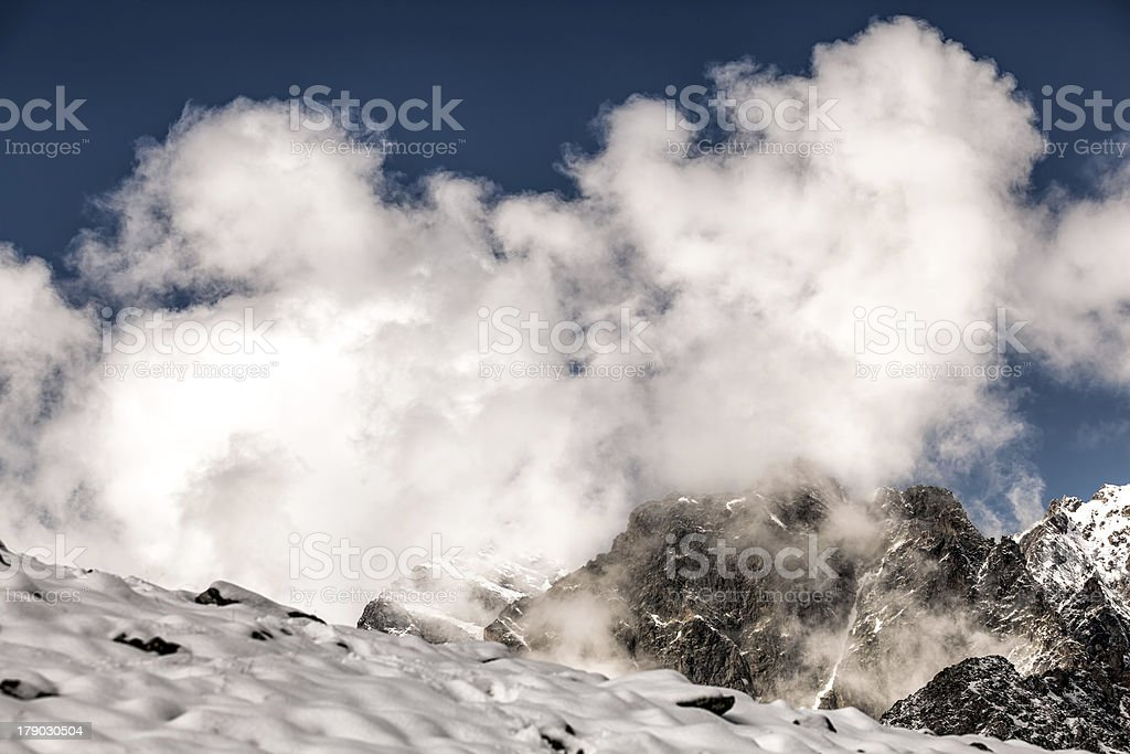 White clouds in the rugged mountains of Caucasus royalty-free stock photo