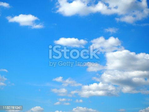 istock White clouds on blue sky. 1132781041