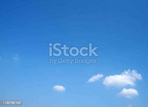 istock White clouds on blue sky. 1132781107