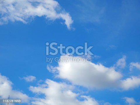 istock White clouds on blue sky. 1132781653