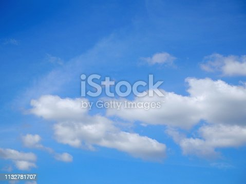 istock White clouds on blue sky. 1132781707
