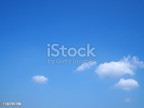 istock White clouds on blue sky. 1132781756