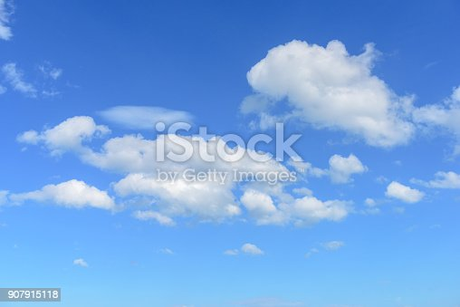 istock White clouds on blue sky. 907915118