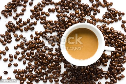 istock White coffee cup and coffee beans . 485865340
