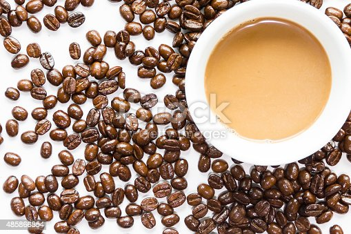 istock White coffee cup and coffee beans . 485866854
